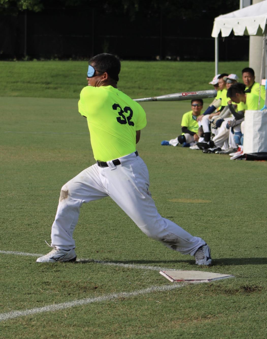 Taiwan Homerun's #32 swings the bat from home plate.