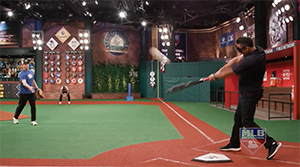 Carlos Pena swings and connects with the beep baseball.